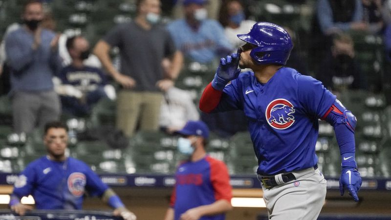 Chicago Cubs' Willson Contreras gestures to the crowd after hitting a two-run home run during...