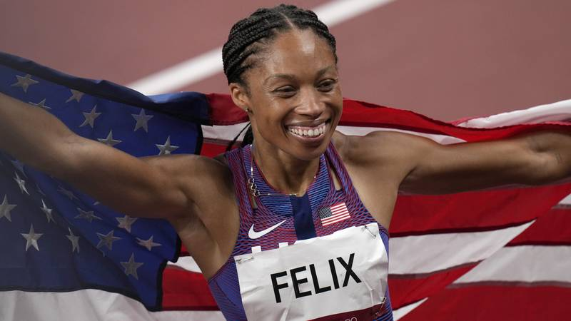 Allyson Felix, of United States smiles after taking the bronze, in the final of women's...