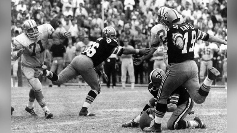 In this Nov. 8, 1970 file photo, New Orleans Saints' Tom Dempsey (19), who is missing a hand...