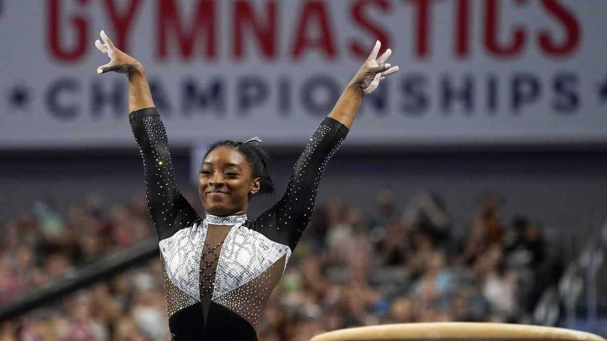 Simone Biles celebrates after competing in the vault during the U.S. Gymnastics Championships,...