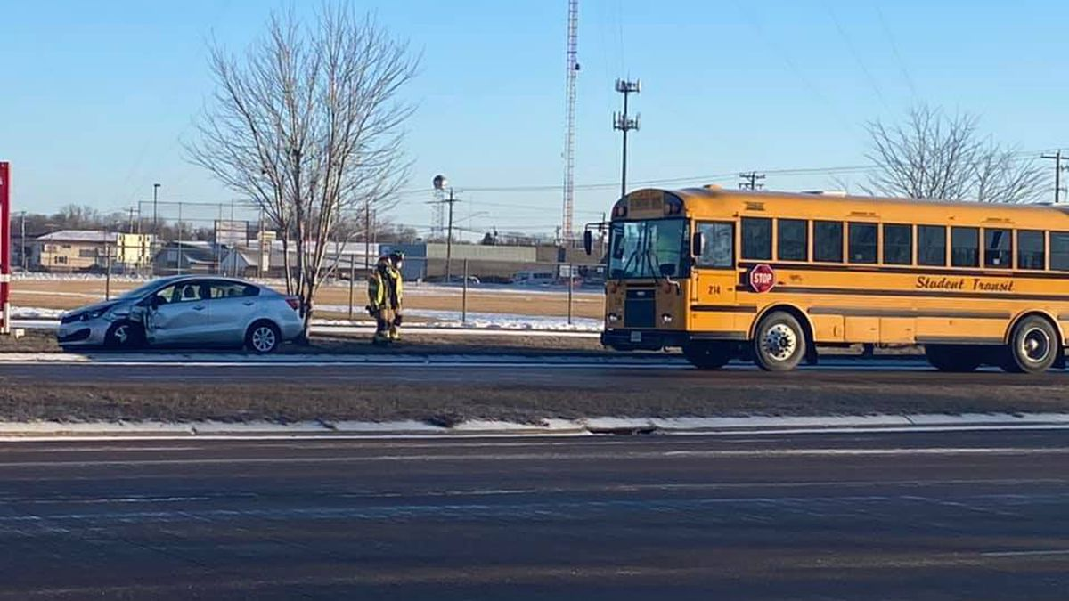 Traffic reduced to one lane as crews respond to crash involving one car and a school bus.