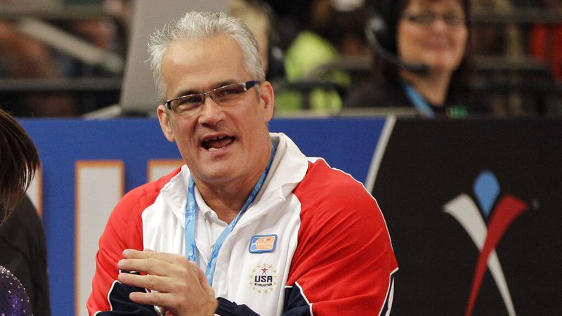 FILE - In this March 3, 2012, file photo, gymnastics coach John Geddert is seen at the American...