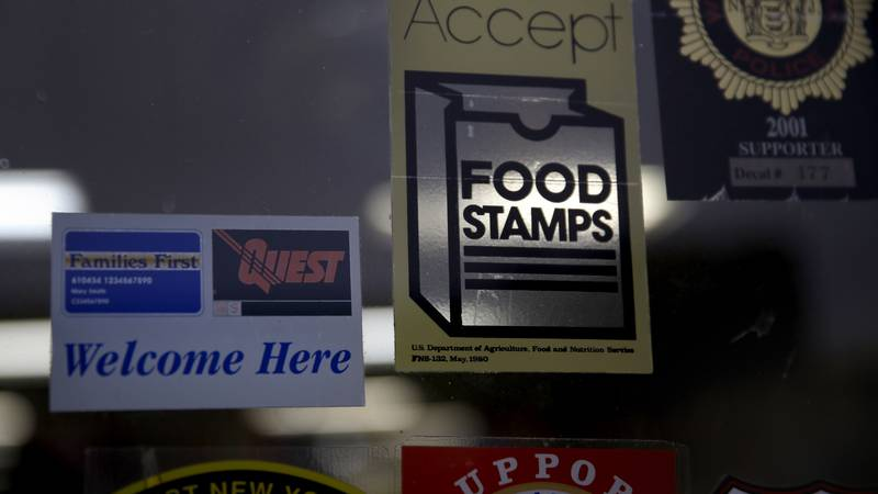 FILE - In this Jan. 12, 2015 file photo, a supermarket displays stickers indicating they accept...