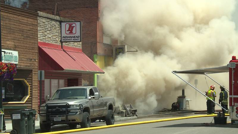 Crews working to put out a fire at Tugger's Cafe & Catering in Augusta, Wis. on Sunday, June...