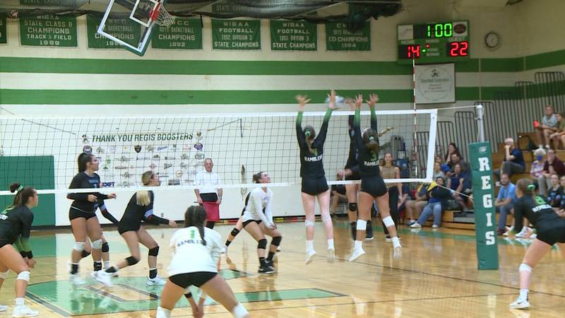 Eau Claire North and Regis meet in volleyball.