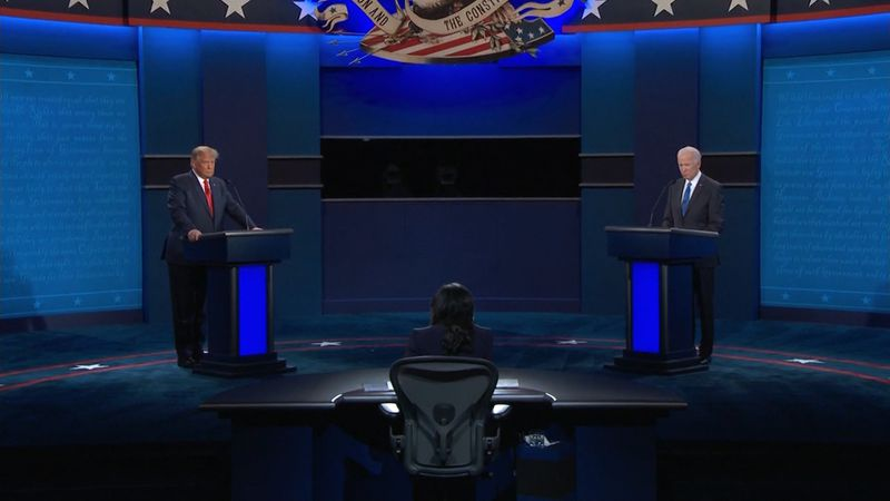 President Donald Trump and former Vice President Joe Biden on stage at the second 2020...
