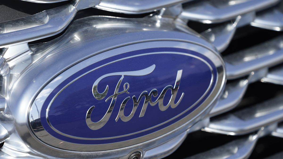 The company logo sparkles off the grille of an unsold 2020 Explorer sports-utility vehicle at a...