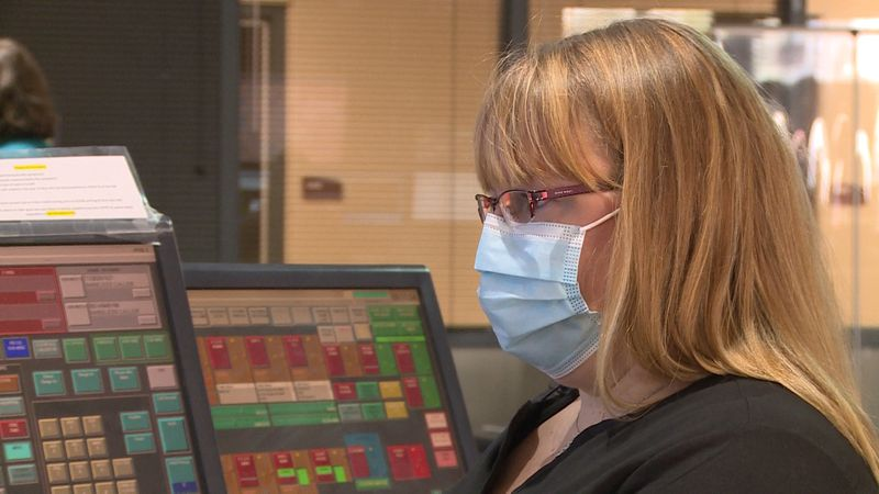 Eau Claire Telecommunicator Danielle Wik working at the city's Communications Center in Eau...