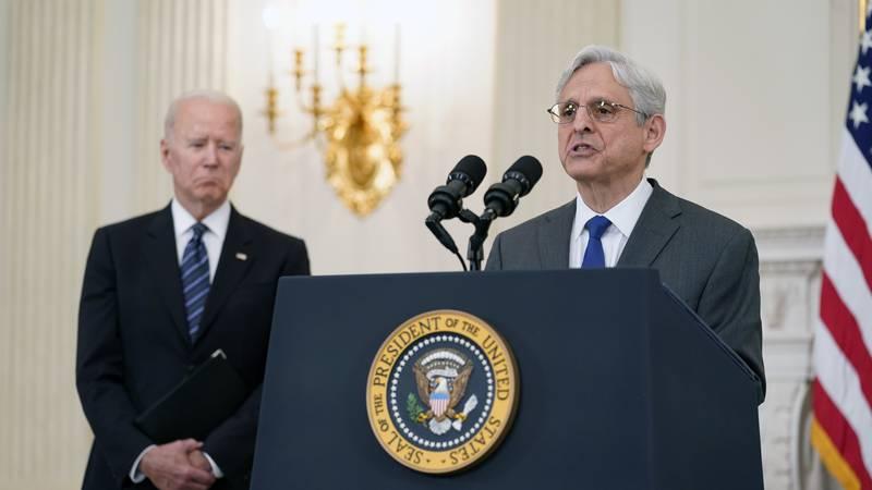 FILE - In this June 23, 2021 file photo, President Joe Biden listens as Attorney General...
